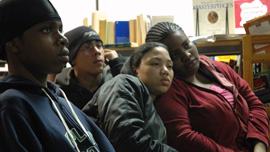 Anthony, Joel, Karina, and Pearl listening to another student read at the library