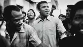 Muhammad Ali walks through the streets of NYC with members of the Black Panther Party, Sept 1970