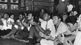 Ali prays at Hussein Mosque in Cairo, June 1964, after announcing he is part of the Nation of Islam