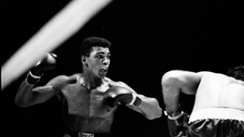 Cassius Clay lowers the boom, as he heads to a championship bout with Sonny Liston