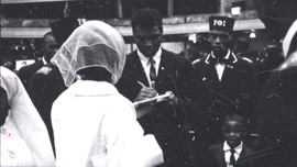 Muhammad Ali signing autographs at NOI Convention