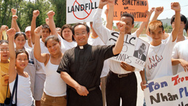 Mimi C. Nguyen, Father Luke Nguyen, and Versailles youth celebrate victory at the Chef Menteur Landfill protest, 2006