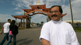 Father Vien Nguyen watches as young parishioners arrive at Church, 2009