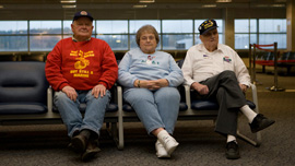 Jerry Mundy, Joan Gaudet, and Bill Knight waiting at the airport