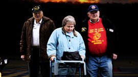 Bill Knight, Joan Gaudet, and Jerry Mundy leave the airport