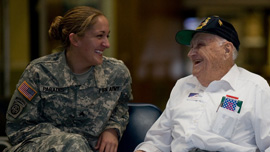 Bill Knight talks with a female soldier at the airport