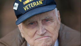 Bill Knight poses in his yard before going to the airport to greet returning troops