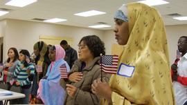 Students recite the Pledge of Allegiance during ESL class.