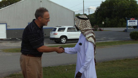 Pastor Stephen Caine and Imam Mohamed Ali meet.