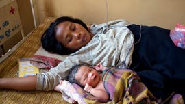 Hi Sokha and her baby in Kratie, Cambodia