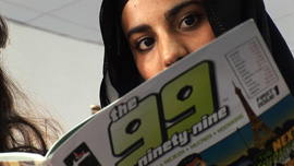 A girl in Kuwait reading THE 99 in her school's library
