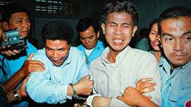 Sok Sam Oeun and Born Samnang are dragged from the courtroom after being convicted of murdering Chea Vichea.