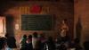 Xiao Zhao teaches Yi Minority school children the National Anthem of China.
